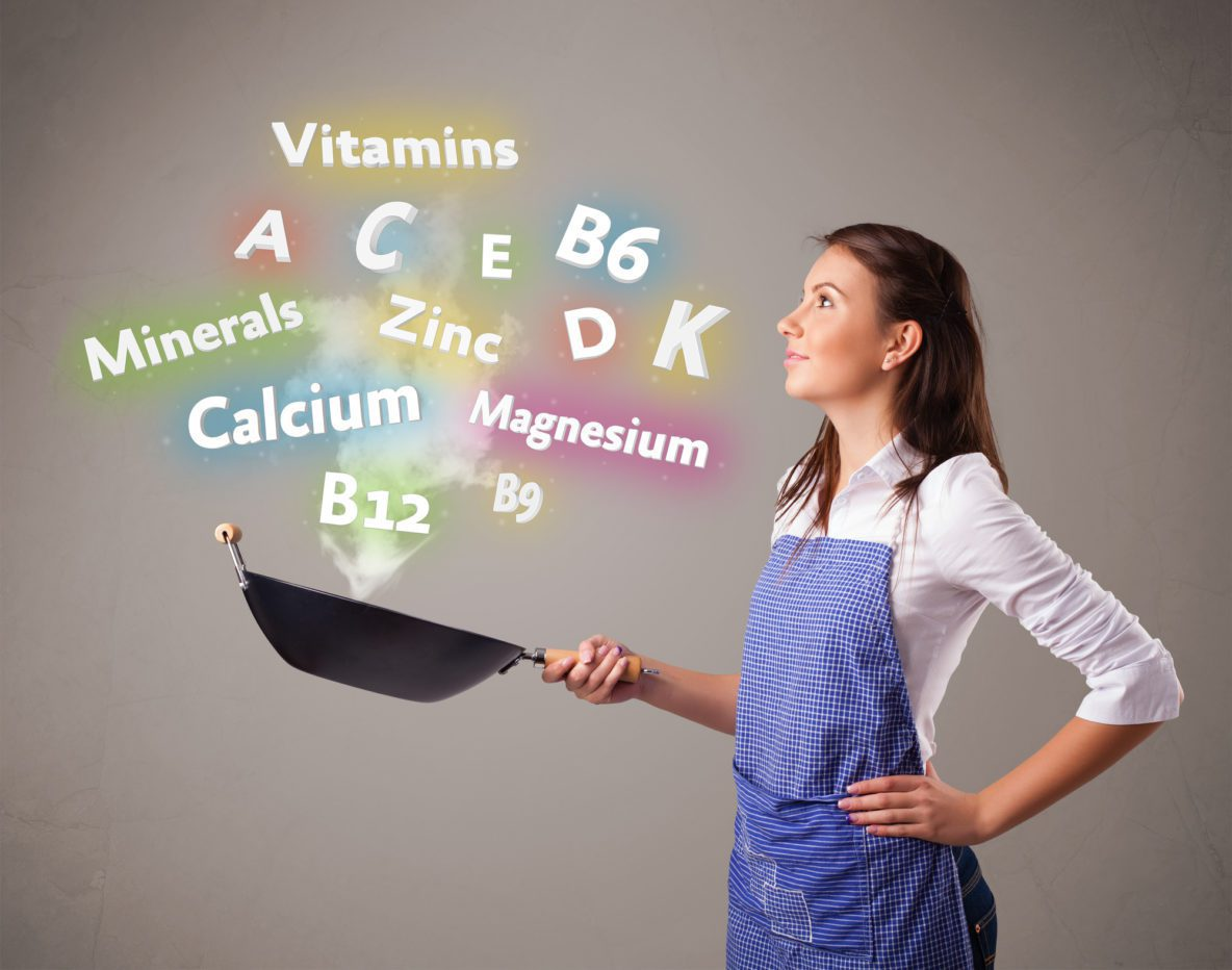 Woman with vitamins and minerals in her frying pan