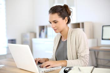 Woman researching on laptop about menopause