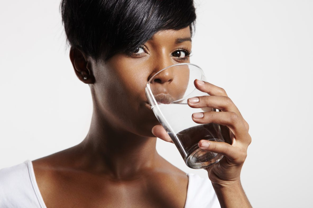 young black woman drinking water